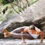Woman with low fatigue doing yoga by a temple