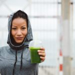 woman offering green drink to detoxify